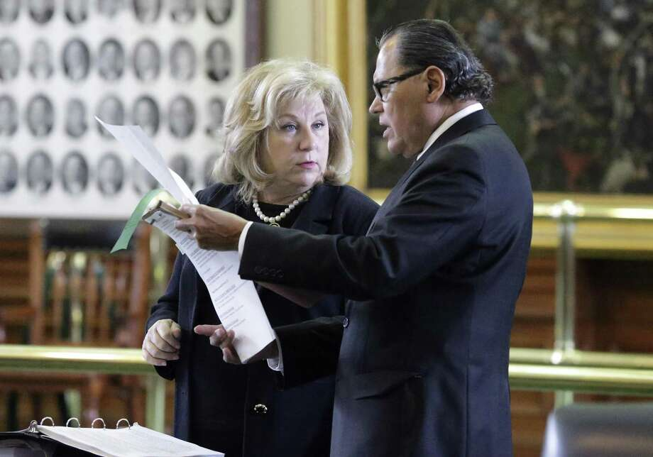 Senators Jane Nelson and Senator Jose Rodriguez go over the legislation as the Texas Senate takes up its budget proposal on the floor in the Capitol on March 28, 2017. Photo: Tom Reel, Staff / San Antonio Express-News / 2017 SAN ANTONIO EXPRESS-NEWS