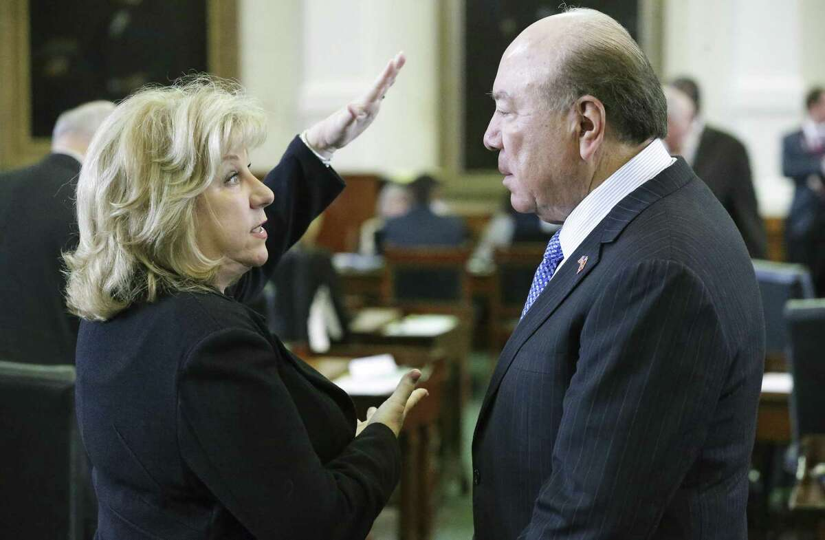 Senate Finance Committee Chair Jane Nelson, R-Flower Mound, discusses the budget bill with Sen. Juan Hinojosa, D-McAllen, who is vice chair of the committee.