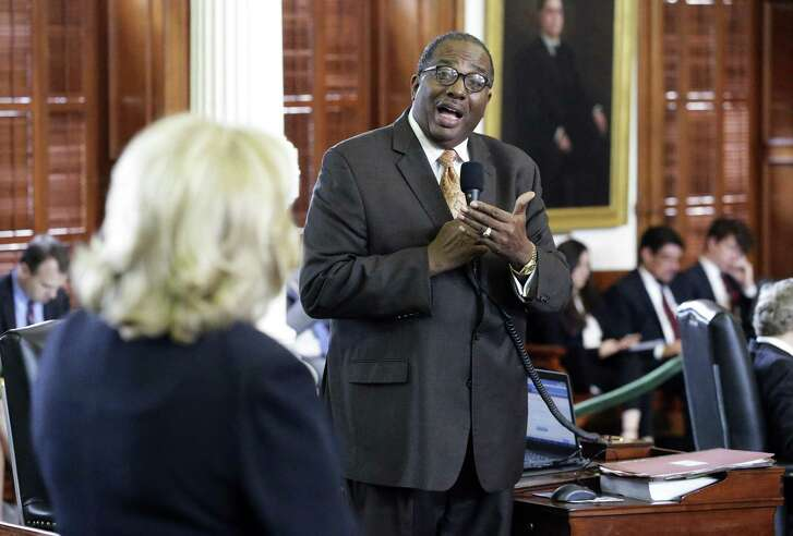 Senator Royce West expresses his reservations to Senate Finance Committee chairman Senator Jane Nelson as the Texas Senate takes up its budget proposal on the floor in the Capitol on March 28, 2017.