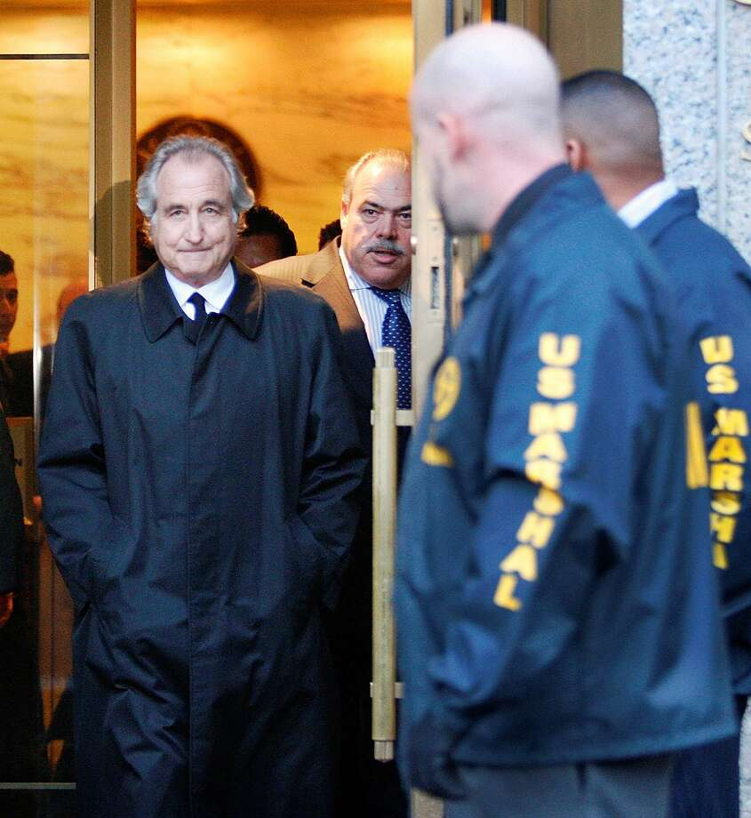 Disgraced financier Bernard Madoff leaves U.S. District Court in Manhattan after a bail hearing in New York, Monday, Jan. 5, 2009. A hedge fund manager linked to Madoff's crimes died Monday in an apparent suicide. Photo: Kathy Willens / ST / AP