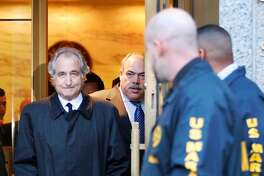 Disgraced financier Bernard Madoff leaves U.S. District Court in Manhattan after a bail hearing in New York, Monday, Jan. 5, 2009. A hedge fund manager linked to Madoff's crimes died Monday in an apparent suicide.