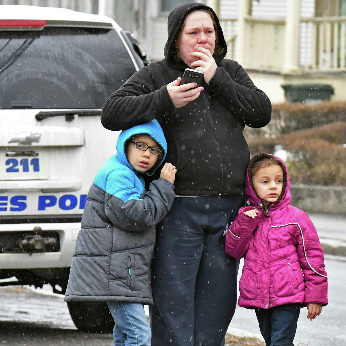 Former neighbor Amanda Jennings of Cohoes, watches with her children Donovan Carrington, 8, left, and Aliyah Carrington, 5 as firefighters battle a house fire at 292 Saratoga Street Tuesday March 28, 2017 in Cohoes, NY. (John Carl D'Annibale / Times Union)