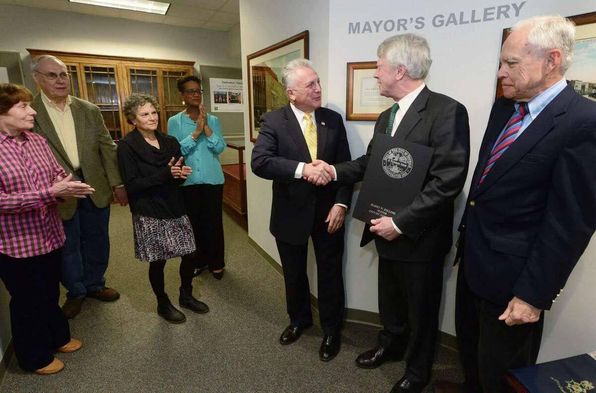 Norwalk Mayor Harry Rilling, center, issues a proclamation declaring April American Revolution Month, Tuesday March 28, 2017, and presents it to Ed Hynes, the curator of the Westport Historical Society's Danbury Raid exhibit, The British are Coming!, while Jo-Anne Schultz and Tom Schierloh of the Norwalk Historical Society, Sue Gold, Director of the Westport Historical Society, Diane Jellerette, Executive Director of the Norwalk Historical Society and Robert Mitchell, president of the Westport Historical Society, right, look on during the brief ceremony at Norwalk City Hall in Norwalk, Conn. The Westport Historical Society and the City of Norwalk declared April American Revolution Month in recognition of the Danbury raid of April, 1777. The exhibit, British are Coming! opens April 2nd.
