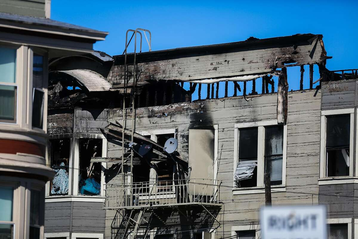 The remains of an apartment complex that was destroyed in a four-alarm fire yesterday on San Pablo Avenue in Oakland, California, on Tuesday, March 28, 2017.