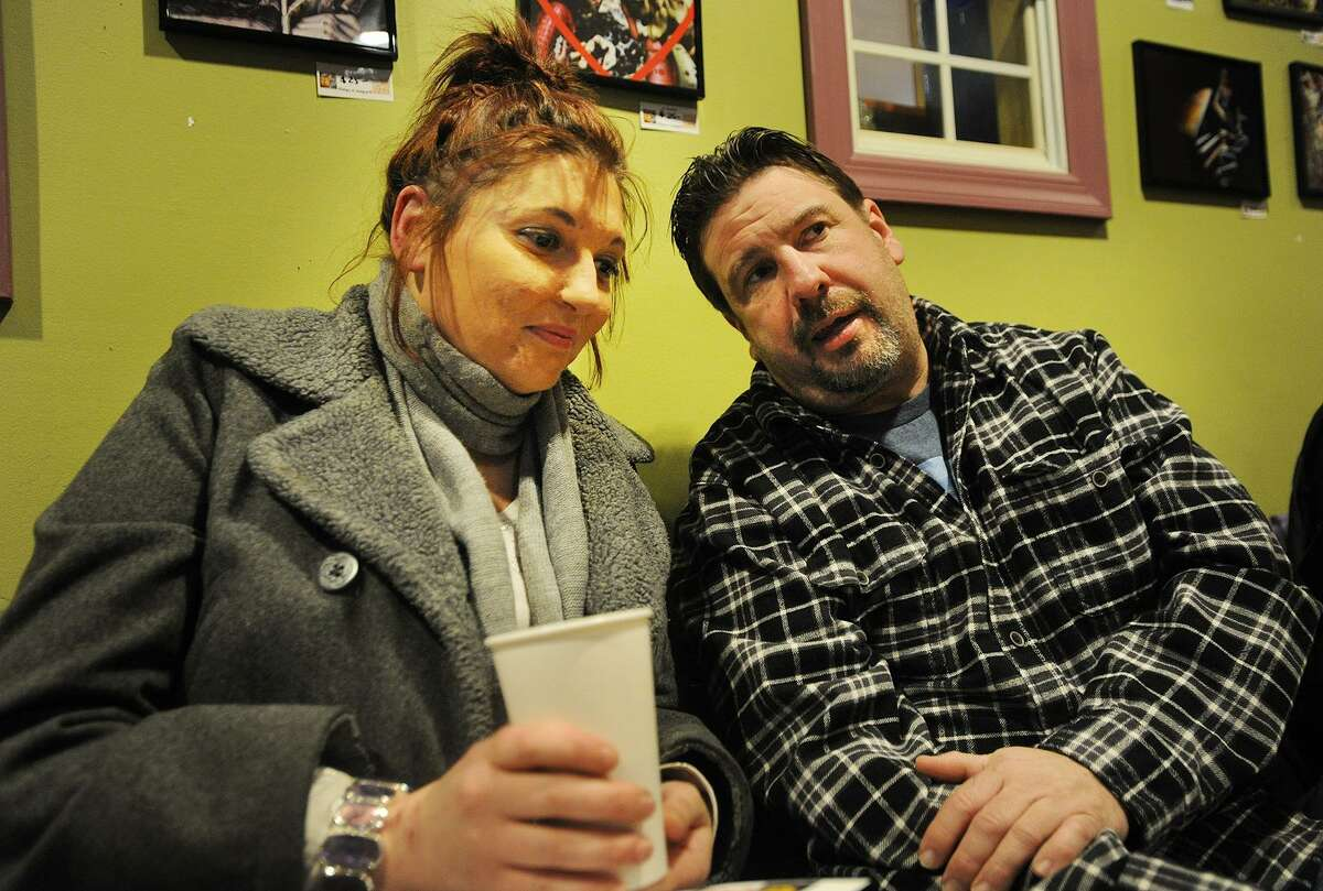 Nicole Torma, left, talks with The Hero Project founder Donald Olson, both of Bethel, during the group's meeting at Molten Java in Bethel, Conn. on Sunday, January 8, 2016.
