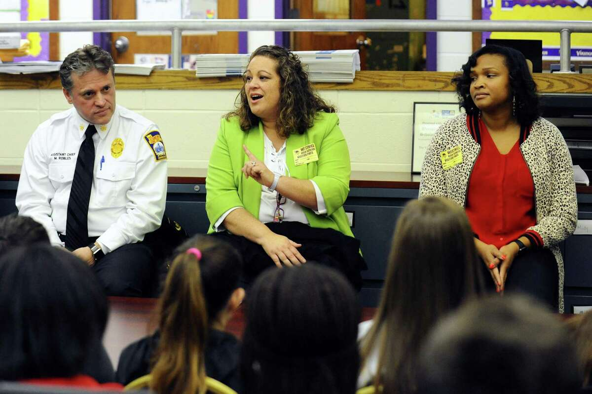 Stamford Public Health Emergency Response Coordinator Elizabeth Rodriguez speaks about her career during a presentation which is part of the first March Career Speaking Tour, an initiative between Westhill High School and the Stamford Public Education Foundation, inside Westhill High School's career center in Stamford, Conn. on Monday, March 27, 2017. Also pictured are Stamford assistant fire chief Michael Robles, left, and public health inspector Patricia Lamothe.