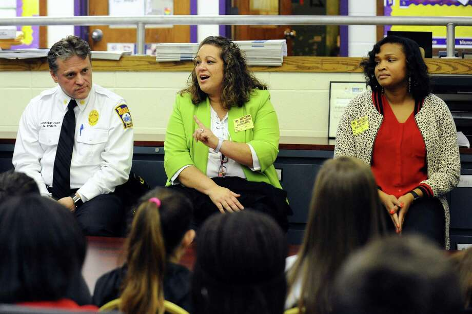Stamford Public Health Emergency Response Coordinator Elizabeth Rodriguez speaks about her career during a presentation which is part of the first March Career Speaking Tour, an initiative between Westhill High School and the Stamford Public Education Foundation, inside Westhill High School's career center in Stamford, Conn. on Monday, March 27, 2017. Also pictured are Stamford assistant fire chief Michael Robles, left, and public health inspector Patricia Lamothe. Photo: Michael Cummo / Hearst Connecticut Media / Stamford Advocate