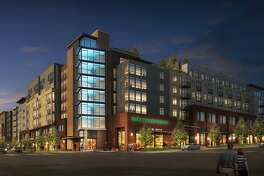 Renderings show what the completed Whittaker development in West Seattle where Whole Foods was set to open a new store until the company backed out this week.