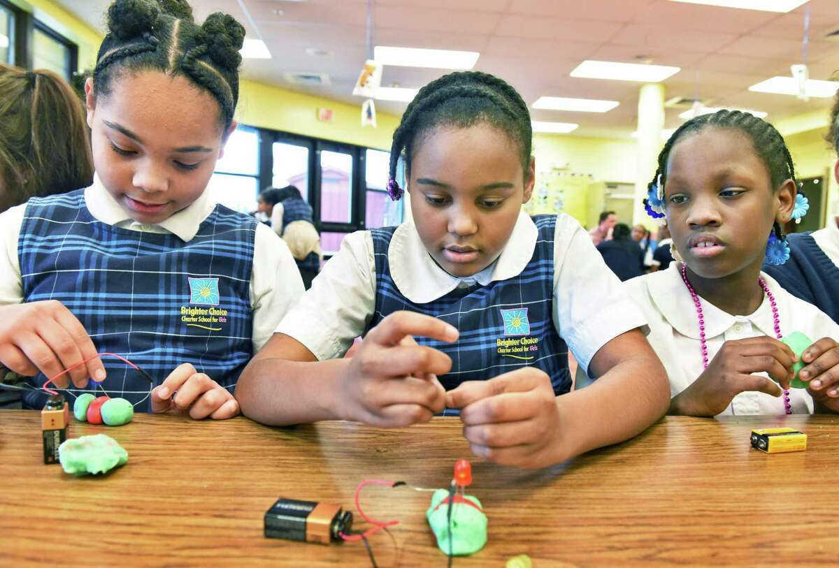 Brighter Choice Charter Elementary fifth graders Naja'hry Coles, left, Kh'mya Brooks, and Zhy'A Codrington, right, experiment with conductive dough during a visit to their school by SUNY Polytechnic Institute for a series of hands-on educational programs Tuesday March 28, 2017 in Albany, NY. (John Carl D'Annibale / Times Union)