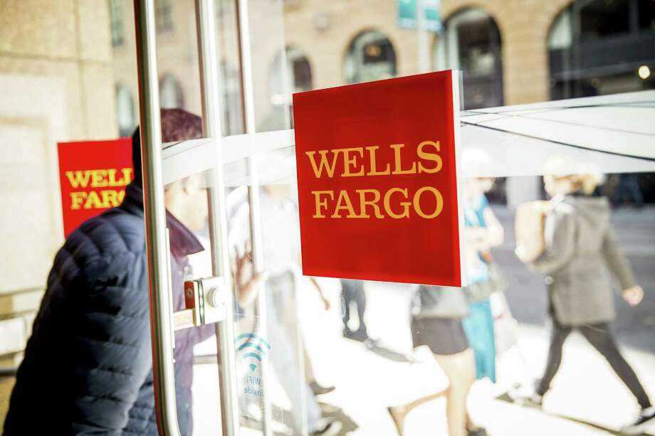 "Proxy adviser Institutional Shareholder Services Inc. says shareholders should vote to remove 12 of Wells Fargo's 15 board members because they failed to provide ""timely and sufficient risk oversight"" to head off a scandal involving the creation of fake customer accounts. Photo: Max Whittaker /New York Times / NYTNS"