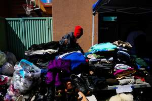 Antigonne Perry looks through donated clothing at the West Oakland Youth Center which is acting as a shelter for those displaced by a four-alarm fire yesterday in Oakland, California, on Tuesday, March 28, 2017. Antigonne's family was displaced by the fire and her daughter Zarinity was sent to the hospital for smoke inhalation.