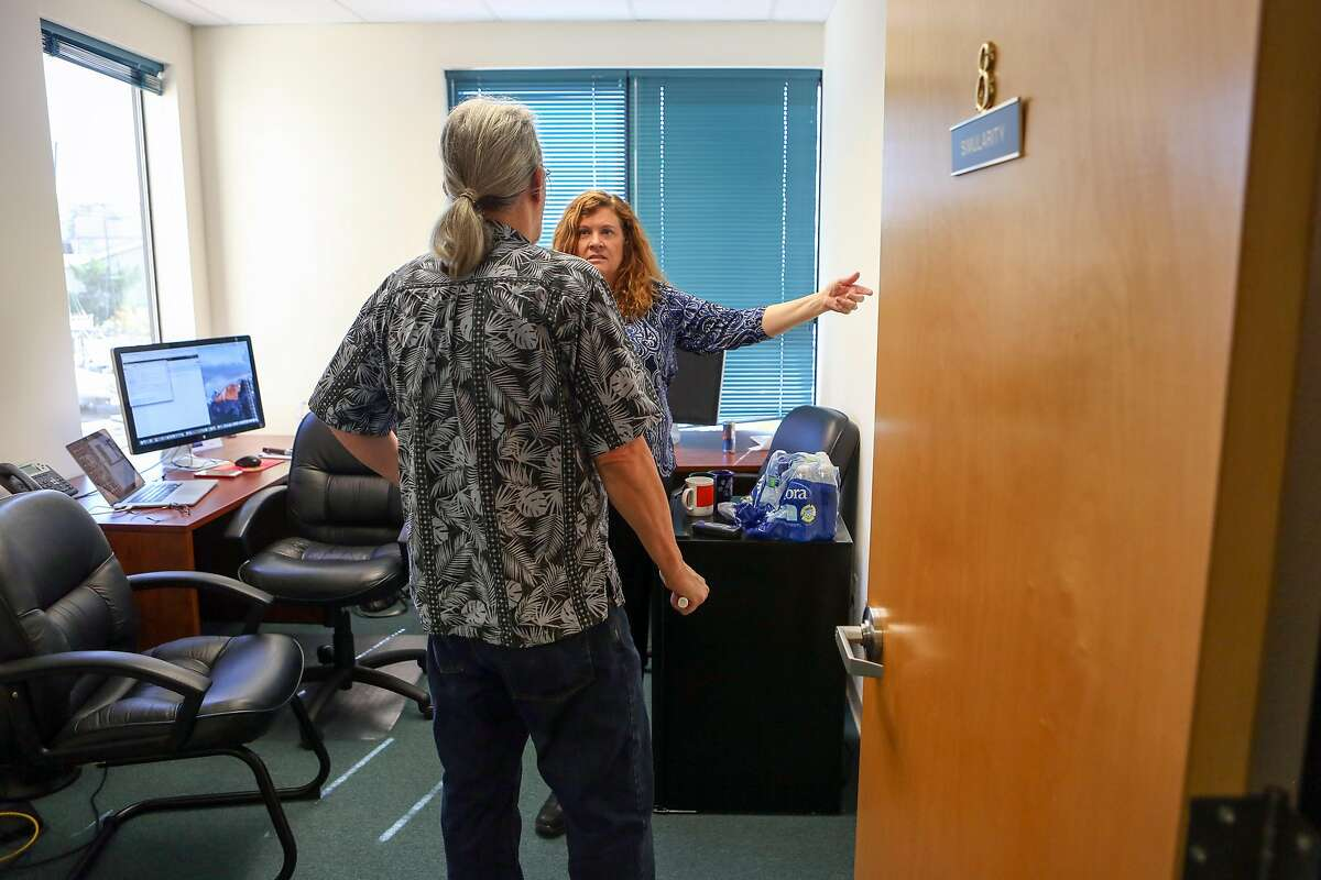 Simularity co-founders Liz Derr and Ray Richardson discuss platform integration of one the company's current projects at their office in Richmond, Calif. on Tuesday, March 28, 2017.