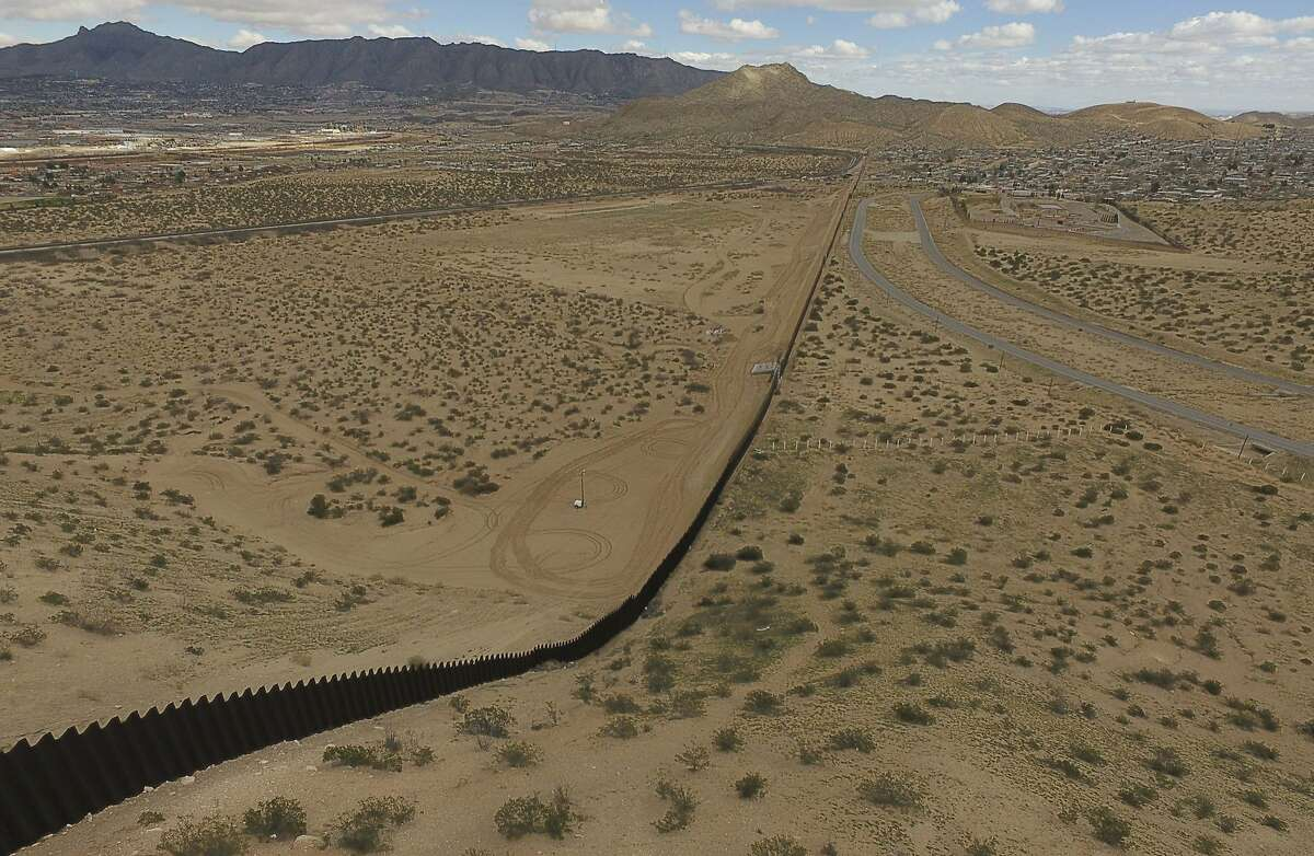 This photo taken on February 19, 2017 shows an aerial view of the metal fence between Mexico (L) and the United States in Puerto Anapra, Chihuahua state. Built to keep out migrants, traffickers, or an enemy group, border walls have emerged as a one-size-fits-all response to the vulnerability felt by many societies in today's globalized world, says an expert on the phenomenon. Practically non-existent at the end of World War II, by the time the Berlin Wall fell in 1989 the number of border walls across the globe had risen to 11. That number has since jumped to 70, prompted by an increased sense of insecurity following the September 11, 2001 attacks in the United States and the 2011 Arab Spring, according to Elisabeth Vallet, director of the Observatory of Geopolitics at the University of Quebec in Montreal (UQAM). This image is part of a photo package of 47 recent images to go with AFP story on walls, barriers and security fences around the world. More pictures available on afpforum.com / AFP PHOTO / YURI CORTEZYURI CORTEZ/AFP/Getty Images