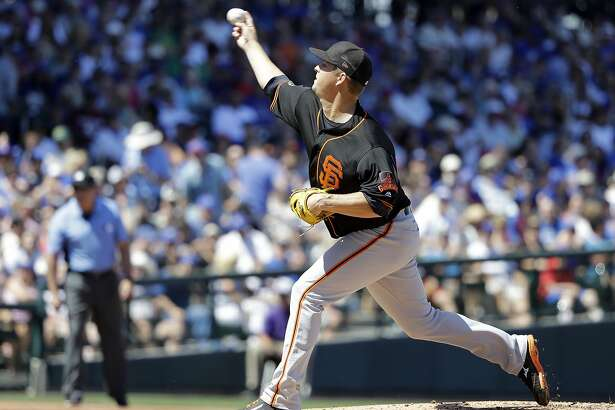 San Francisco Giants' Matt Cain throws during the first inning of a spring training baseball game against the Chicago Cubs, Tuesday, March 28, 2017, in Mesa, Ariz. (AP Photo/Darron Cummings)