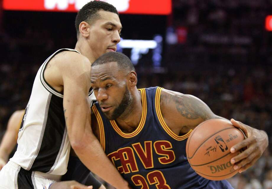 Cleveland Cavaliers forward LeBron James (23) drives against Spurs guard Danny Green during the first half on March 27, 2017, in San Antonio. Photo: Darren Abate /Associated Press / FR115 AP