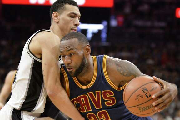 Cleveland Cavaliers forward LeBron James (23) drives against Spurs guard Danny Green during the first half on March 27, 2017, in San Antonio.