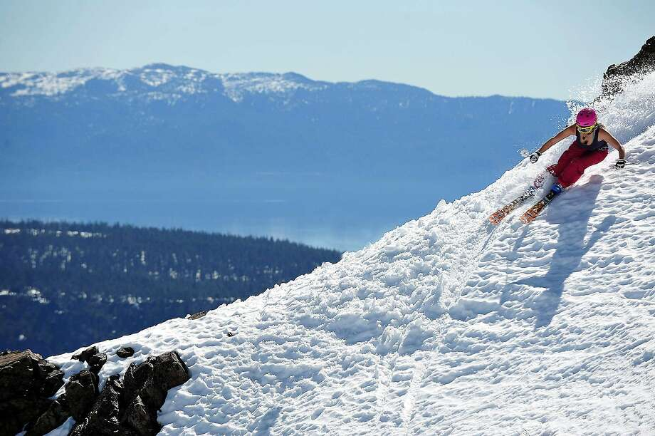 A proposed gondola linking Squaw Valley and Alpine Meadows was approved Tuesday by the Placer County Supervisors. It would allow skiers and riders access to both resorts' slopes without having to drive or take a shuttle between the areas. Photo: Squaw Valley Alpine Meadows