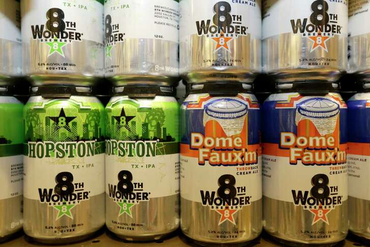 Cans of 8th Wonder beer is shown at Total Wine, 7640 Cypress Creek Parkway, Tuesday, Oct. 25, 2016, in Houston.  Total Wine is a new-to-market liquor store that will opening soon in the Willowbrook area. ( Melissa Phillip / Houston Chronicle )