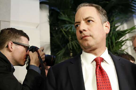 "FILE - In a  March 23, 2017 file photo, White House Chief of Staff Reince Priebus, right, departs after a Republican caucus meeting on Capitol Hill, in Washington. Speaking on ""Fox News Sunday,"" March 26, 2017, Priebus made clear that President Donald Trump would be seeking support from moderate Democrats for upcoming legislative battles.  (AP Photo/Alex Brandon, File)"