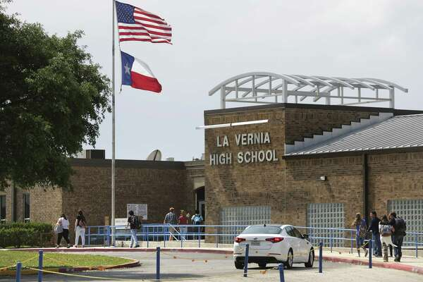 Students walk to the main building at La Vernia High School in La Vernia, TX, on Tuesday, March 28, 2017.