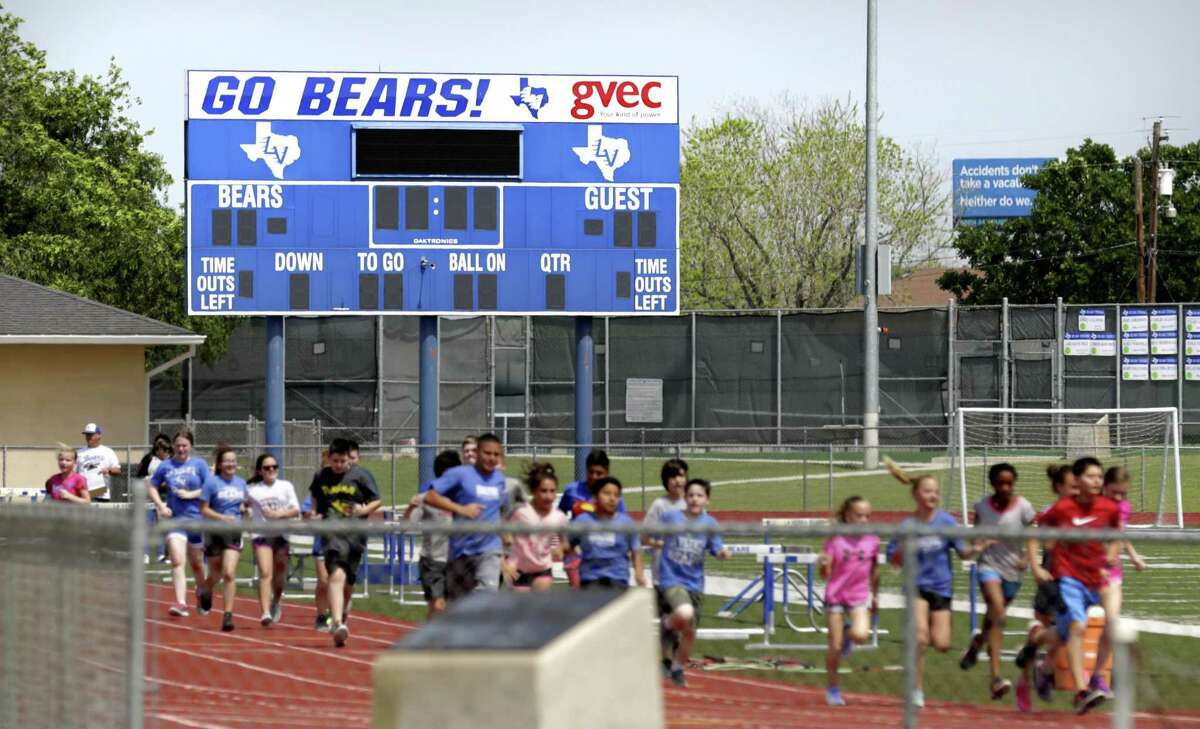Students run on the track at La Vernia High School in La Vernia, TX, on Tuesday, March 28, 2017.