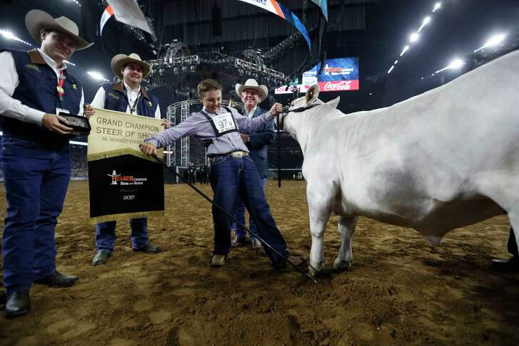 "Jagger Horn, a 15-year-old from Anson, celebrates his steer ""Playa"" being named the Junior Market Steer champion at the Houston Livestock Show and Rodeo on Friday at NRG Park. (Karen Warren / Houston Chronicle)"