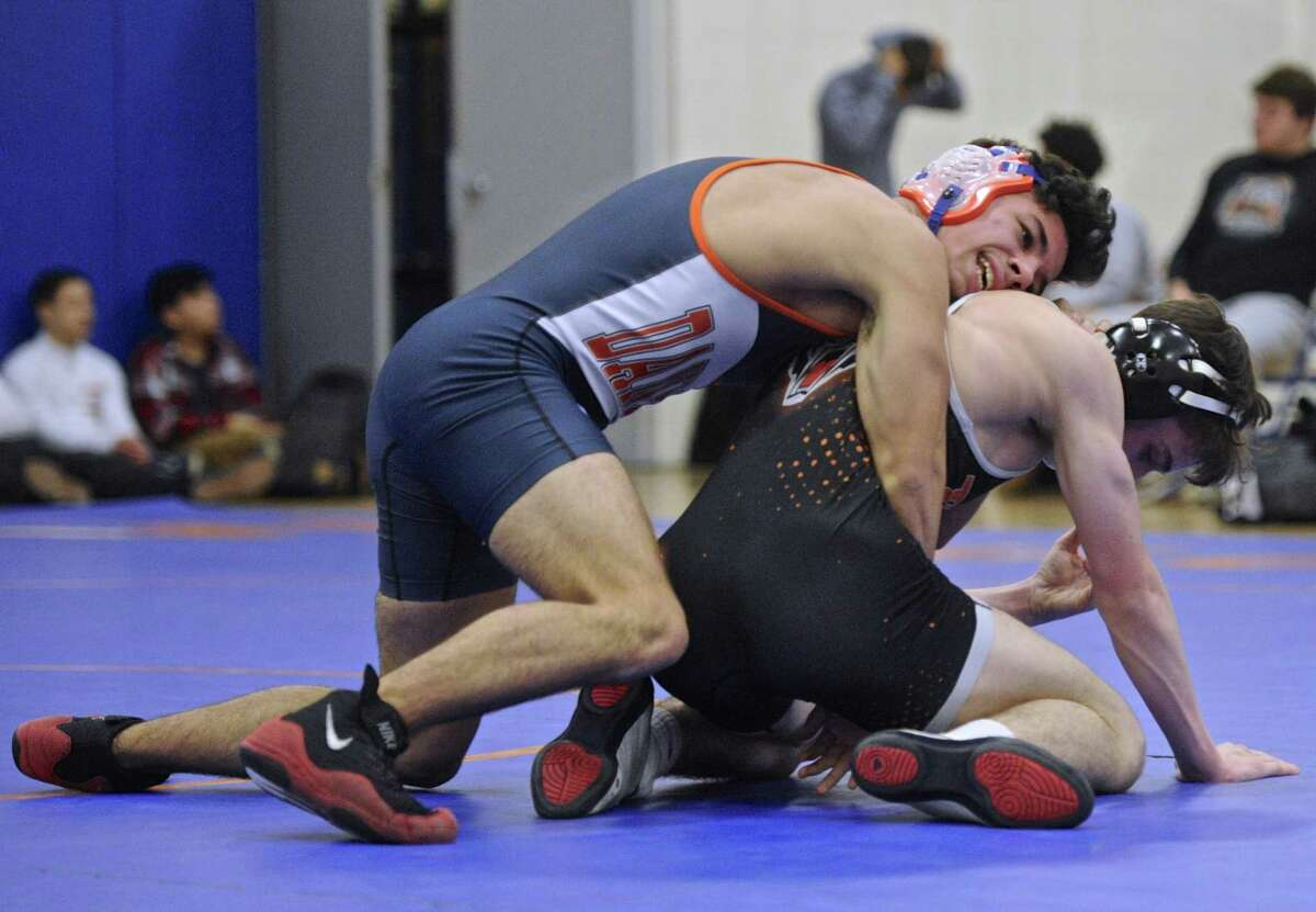 Ridgefield's Peter Murray, right, and Danbury's Kyle Fields, left, wrestle in the 132 pound class during the high school wrestling match between Ridgefield and Danbury high schools, on Wednesday, January 18, 2017, at Danbury High School, in Danbury, Conn.