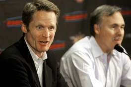 Phoenix Suns president of operations and general manager Steve Kerr, left, and head coach Mike D'Antoni announce the team's acquisition of  Miami Heat center Shaquille O'Neal, Wednesday, Feb. 6, 2008 at US Airways Center in Phoenix.  The Suns acquired O'Neal in a stunning, blockbuster deal that sent four-time All-Star Shawn Marion and Marcus Banks to the Miami Heat. (AP Photo/Matt York)