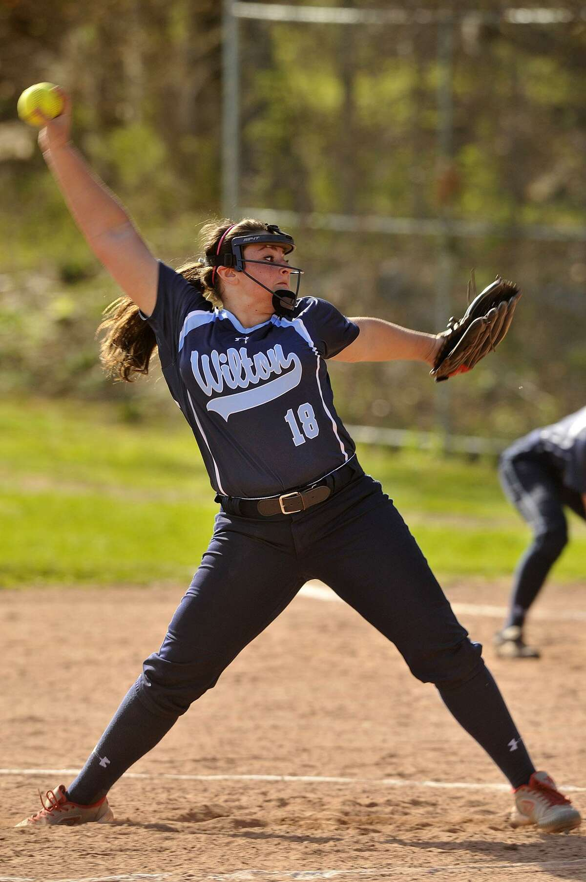Wilton's Sage Zunda winds up during an April 2015 game against Westhill.