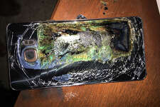 FILE - This Sunday, Oct. 9, 2016, file photo shows a damaged Samsung Galaxy Note 7 on a table in Richmond, Va., after it caught fire earlier in the day. On Tuesday, March 28, 2017, Samsung said it's considering bringing the recalled, fire-prone Note 7 smartphone back to market as a refurbished or rental phone after consulting with regulatory authorities and carriers and assessing local demands. Samsung killed the Note 7 after dozens of phones overheated and caught fire. Samsung conducted extensive tests since then and has blamed multiple design and manufacturing defects in batteries made by two different companies. (Shawn L. Minter via AP, File) ORG XMIT: NYBZ212