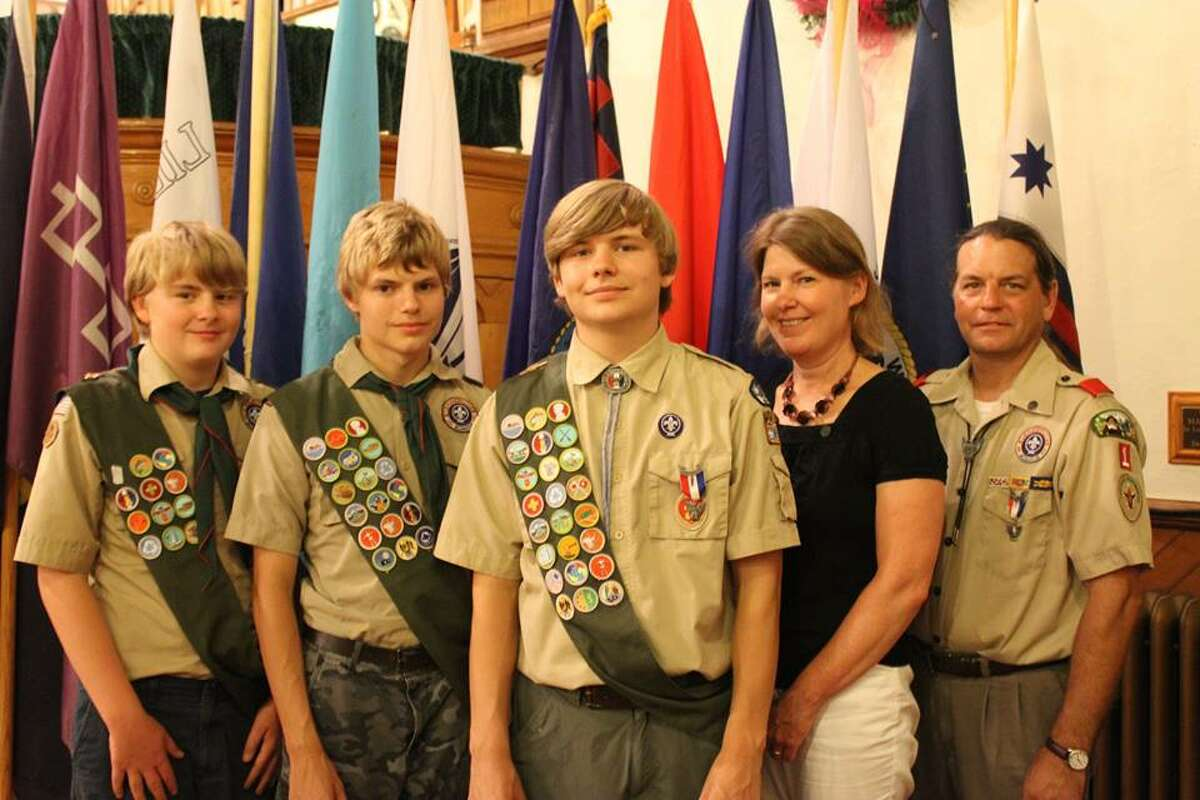 Henry Burkert, center, of Troop 1 in Ballston Spa, received his Eagle Scout Award at a recent Court of Honor at the Ballston Spa United Methodist Church. His project was to design plan a picnic area in Biose Family Park in Rock City Falls. With Burkert are: Amy Burkert, mother, second from right, Karl Burkert, father and Eagle Scout, far right, and brothers Bill Burkert, far left, and Karl Burkert, second from left. (Photo provided) ORG XMIT: 5uB_nj3Qs78Vm60rzKi1