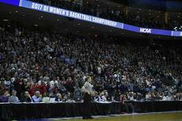 Fans stand to watch the start of the regional final game between Oregon and Connecticut in the NCAA women's college basketball tournament, Monday, March 27, 2017, in Bridgeport, Conn. (AP Photo/Jessica Hill)