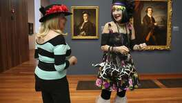 Shelia Ash, owner of Noe's Nest bed and breakfast, talks to her friend Barbara at the Bouquets to Art exhibit at the de Young museum in San Francisco, Calif. Tuesday, March 14, 2017.