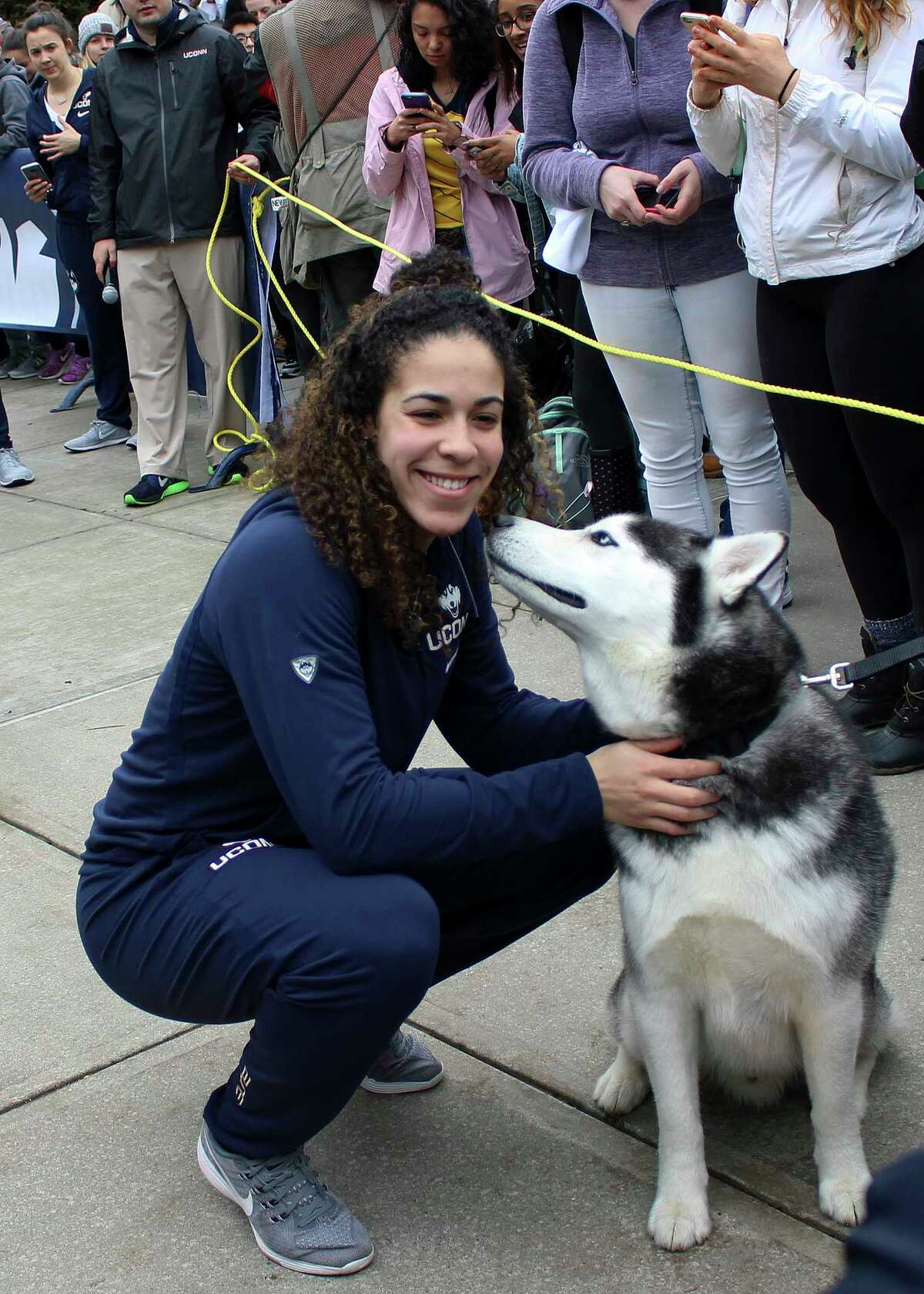 Connecticut's Kia Nurse pets school mascot Jonathan, the Husky, during a send-off rally for the women's basketball team Tuesday, March 28, 2017, outside Gampel Pavilion in Storrs, Conn., as they prepare to board a bus to depart for the Final Four of the NCAA college basketball tournament in Dallas. (AP Photo/Pat Eaton-Robb) ORG XMIT: RPPR103