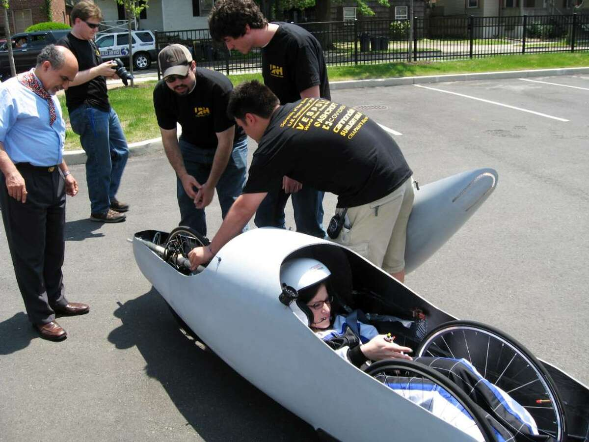 On Tuesday June 1, 2010, students and professors at the University of New Haven work on their 500 mpg experimental vehicle that will be entered in the national Supermileage Competition in Michigan next week. The 250-pound car is powered by a one-cylinder engine and has a shell of carbon fiber. The driver is Kacee Lawlor from Beacon, N.Y. Assoc. Dean Ali Montazer, Roy Pilletere from West Haven, Colton Murphy from Bennington Vt and Thomas Ford of Bethel work to get the car ready for a test run. In the back, taking photos of the event is Stephen Hegedus from Bethel, CT.