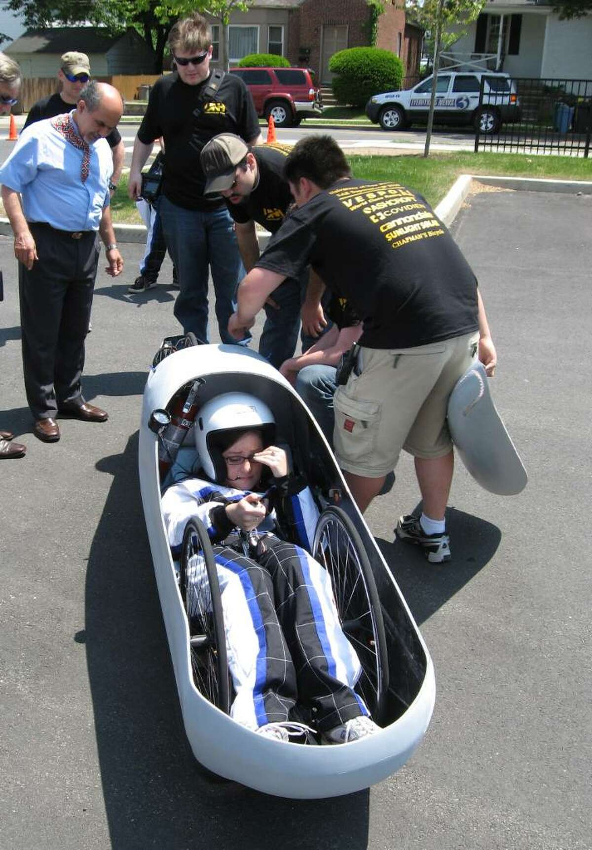 On Tuesday June 1, 2010, students and professors at the University of New Haven work on their 500 mpg experimental vehicle that will be entered in the national Supermileage Competition in Michigan next week. The 250-pound car is powered by a one-cylinder engine and has a shell of carbon fiber. The driver is Kacee Lawlor from Beacon, N.Y. Assoc. Dean Ali Montazer, Stephen Hegedus from Bethel, Roy Pilletere from West Haven and Thomas Ford of Bethel work to get the car ready for a test run.