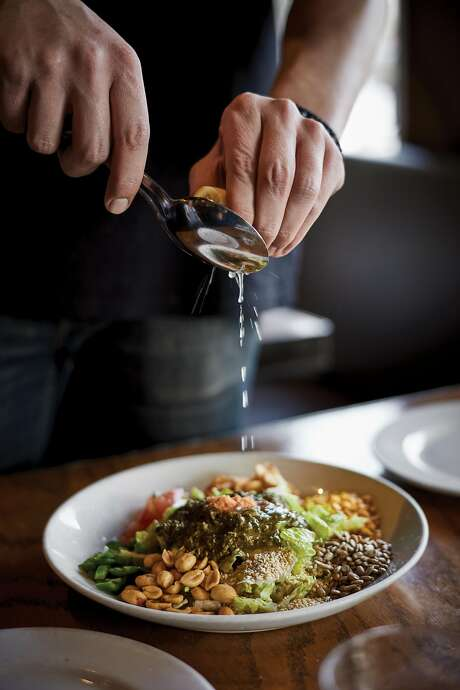 """The tea leaf salad from """"BurmaSuperstar: Addictive Recipes from the Crossroads of Southeast Asia"""" by Desmond Tan and Kate Leahy (Ten Speed Press; 272 pages; $29.99) Photo: John Lee, Courtesy Ten Speed Press"""