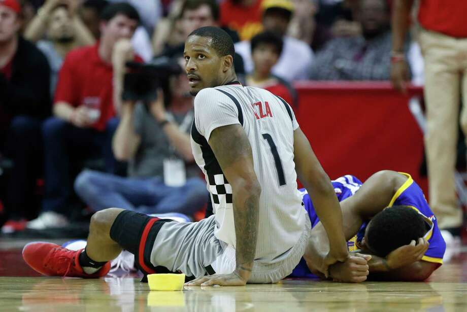 Houston Rockets forward Trevor Ariza (1) reacts after colliding with Golden State Warriors forward James Michael McAdoo (20), who was injured on this play during the first half of an NBA basketball game at the Toyota Center, Tuesday, March 28, 2017, in Houston. Photo: Karen Warren, Houston Chronicle / 2017 Houston Chronicle