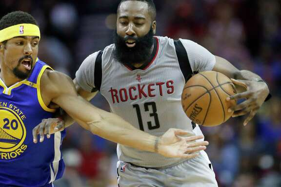 Houston Rockets guard James Harden (13) comes up the court against the defense of Golden State Warriors forward James Michael McAdoo (20) during the first half of an NBA basketball game at the Toyota Center, Tuesday, March 28, 2017, in Houston.
