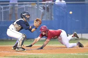 Cy-Ranch catcher Jared Alvarez-Lopez waits for the ball as Cy Woods Gerado Petitto slides safe into home after a double by Garrett Kellogg Clarke Tuesday, March 28, 2017, in Cypress.