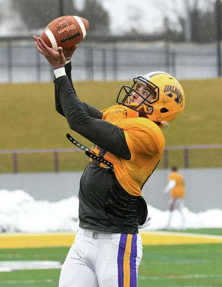 University at Albany wide receiver Brad Harris catches the ball as the football team practices on Tuesday, March 28, 2017 in Albany, N.Y.  (Lori Van Buren / Times Union) Photo: Lori Van Buren / 20040084A