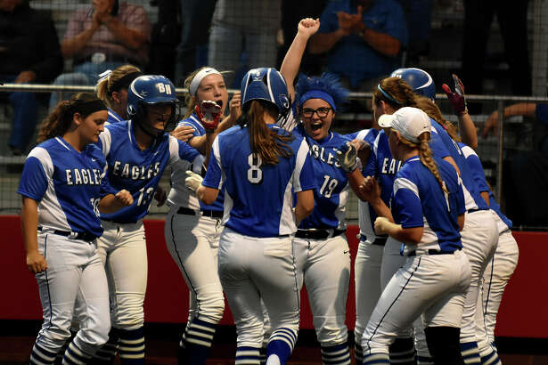 Barbers Hill junior Cassidy Thrash (19) and her Lady Eagle teammates wait at homeplate to congratulate senior Meagan King (8) after her two-run homerun in the top of the 5th inning against Crosby in their District 21-5A matchup at Crosby High School on Tuesday, March 28, 2017. (Photo by Jerry Baker/Freelance)