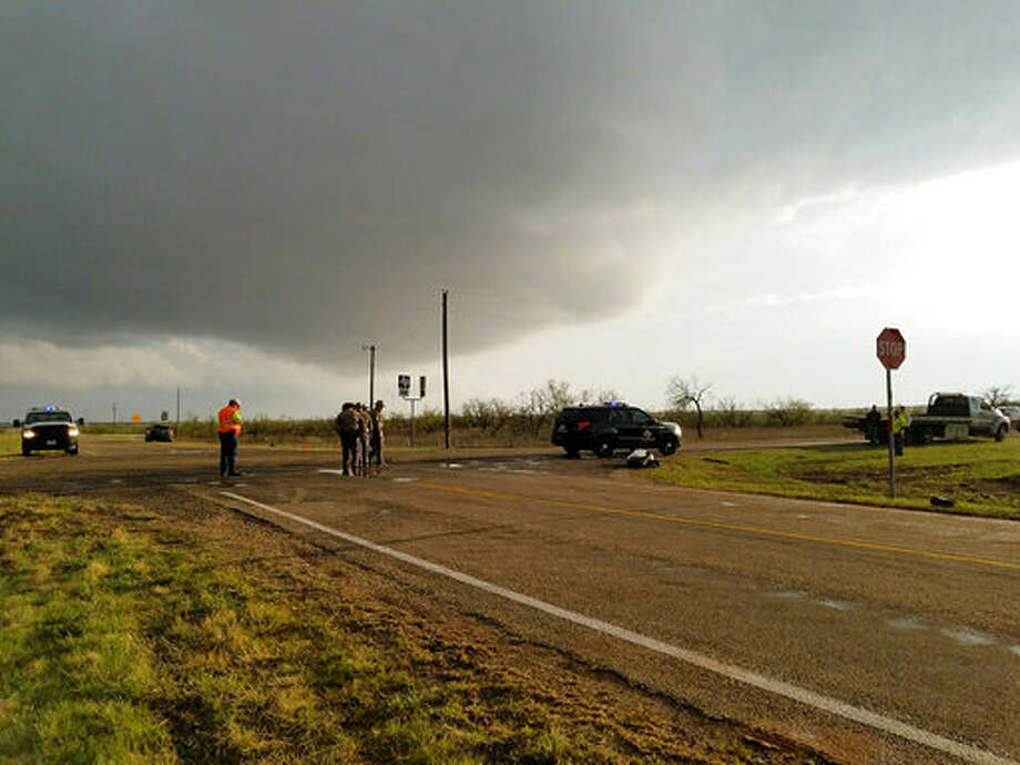 Texas Department of Public Safety troopers investigate a two-vehicle crash that left several storm chasers dead Tuesday, March 28, 2017, near Spur, Texas. The storms spawned multiple funnel clouds and an occasional tornado in open areas of West Texas on Tuesday afternoon. The crash happened at a remote intersection near the town of Spur, about 55 miles southeast of Lubbock. (Ellysa Gonzalez/Lubbock Avalanche-Journal via AP) Photo: Ellysa Gonzalez/AP