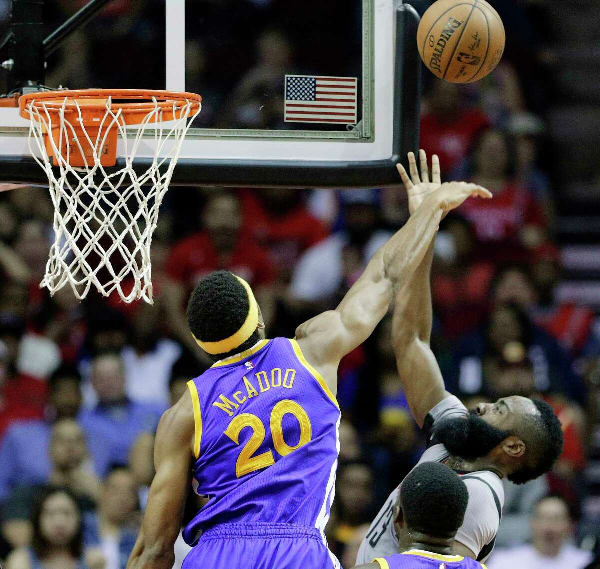 Golden State Warriors' James Michael McAdoo (20) knocks away the shot attempt by Houston Rockets' James Harden (13) in the first half of an NBA basketball game in Houston, Tuesday, March 28, 2017. (AP Photo/Michael Wyke) ORG XMIT: TXMW105