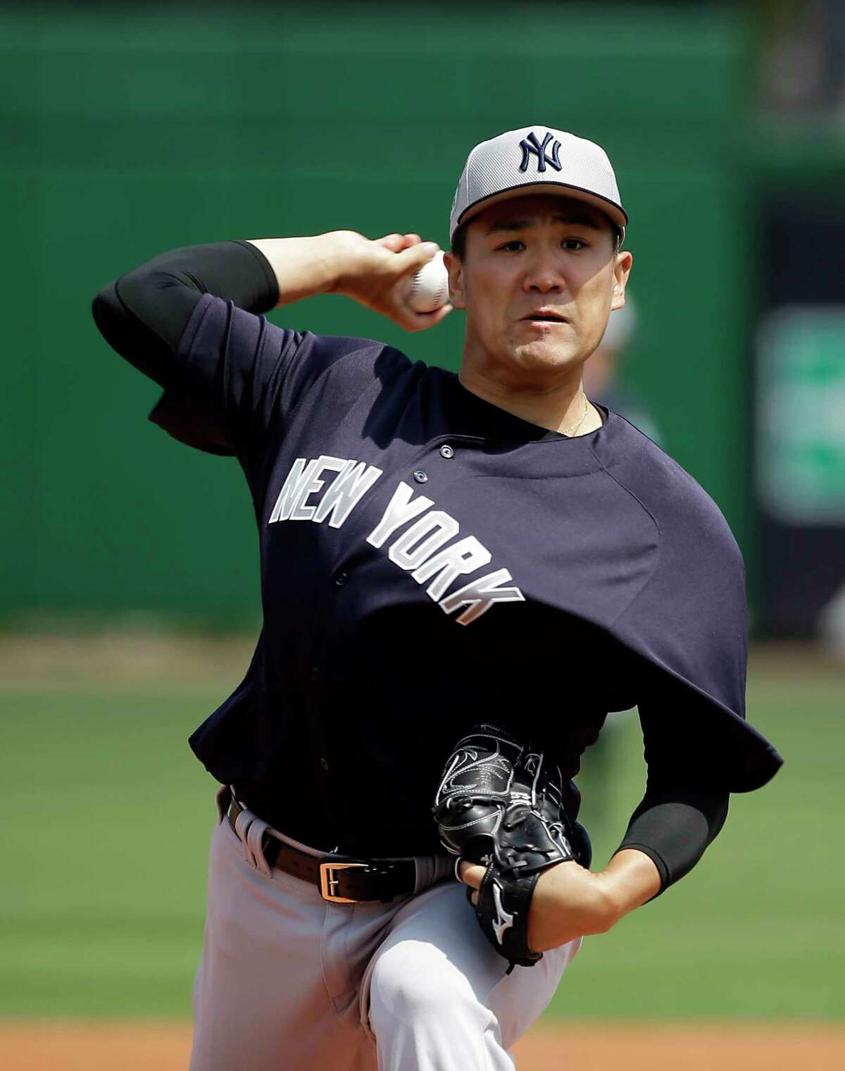 New York Yankees starting pitcher Masahiro Tanaka, of Japan, throws in the first inning of a spring training baseball game against the Philadelphia Phillies, Wednesday, March 22, 2017, in Clearwater, Fla. (AP Photo/John Raoux) ORG XMIT: FLJR101