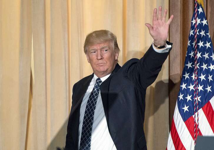 "U.S. President Donald Trump waves after signing an energy independence executive order at Environmental Protection Agency (EPA) headquarters in Washington, D.C. on Thursday, March 28, 2017. Trump moved aggressively to undo his predecessor's carbon-cutting commitments, promising ""a new energy revolution"" that would unleash America's abundant fossil-fuel resources. Photographer Ron Sachs/Pool via Bloomberg"