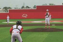 Senior pitcher Daniel Nelson warms up in between innings. Nelson pitched a scoreless complete game,.