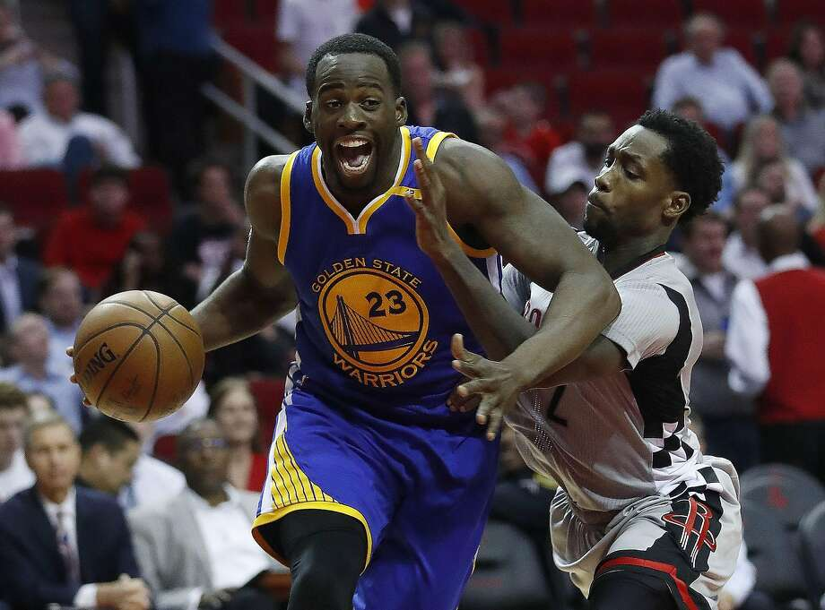 Golden State Warriors forward Draymond Green (23) drives to the basket against Houston Rockets guard Patrick Beverley (2)during the second half of an NBA basketball game at the Toyota Center, Tuesday, March 28, 2017, in Houston. ( Karen Warren / Houston Chronicle ) Photo: Karen Warren, Houston Chronicle