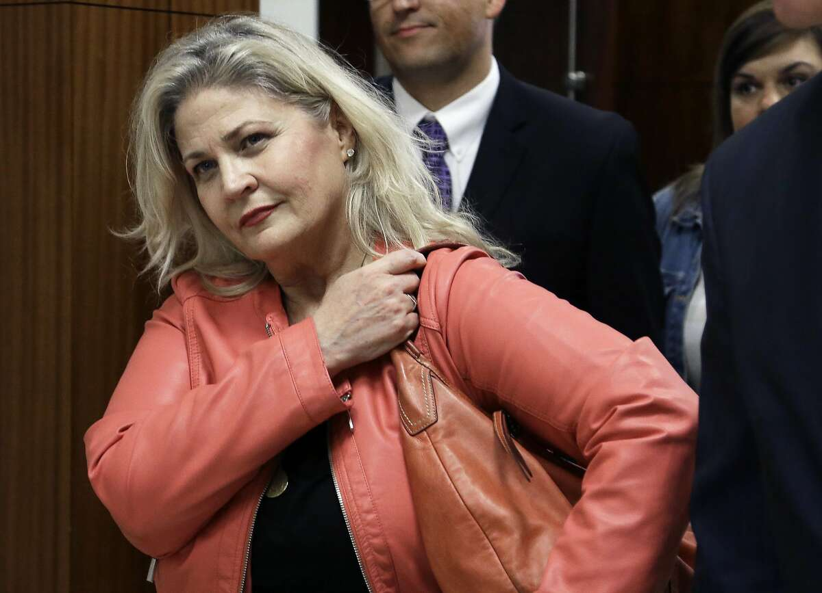 FILE - In this Feb. 3, 2016 file photo, Sandra Merritt, one of the two anti-abortion activists indicted last month, leaves the courtroom after turning herself in to authorities and bonding out in Houston. California prosecutors say two anti-abortion activists who made undercover videos of themselves trying to buy fetal tissue from Planned Parenthood have been charged with 15 felony counts of invasion of privacy. State Attorney General Xavier Becerra announced the charges Tuesday, March 28, 2017, against David Daleiden and Merritt. (AP Photo/Pat Sullivan, File)