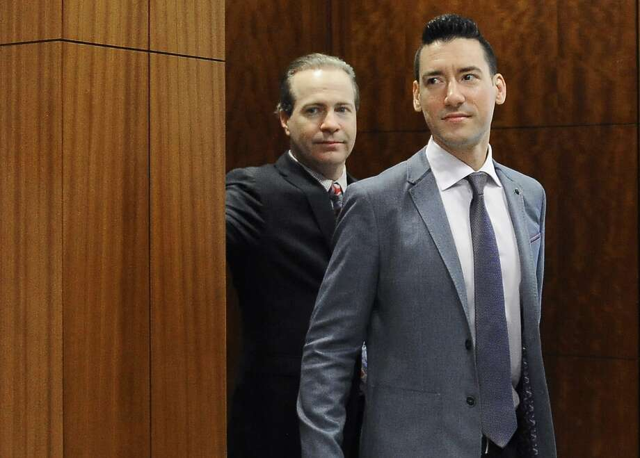 FILE - In this April 29, 2016 file photo, David Robert Daleiden, right, leaves a courtroom after a hearing in Houston. California prosecutors say two anti-abortion activists who made undercover videos of themselves trying to buy fetal tissue from Planned Parenthood have been charged with 15 felony counts of invasion of privacy. State Attorney General Xavier Becerra announced the charges Tuesday, March 28, 2017, against Daleiden and Sandra Merritt. (AP Photo/Pat Sullivan, File) Photo: Pat Sullivan, Associated Press